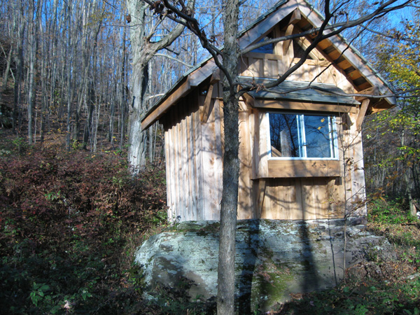 Between a Rock and Stone mark rogers tiny house rock foundation