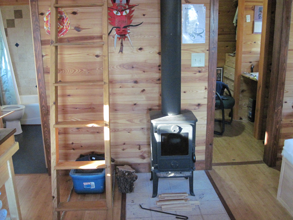 Michael Moore Tiny House Potluck Community Farm stove