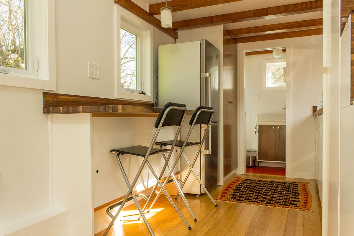 Hikari-Box-Tiny-House-Kitchen-Seating-and-Storage