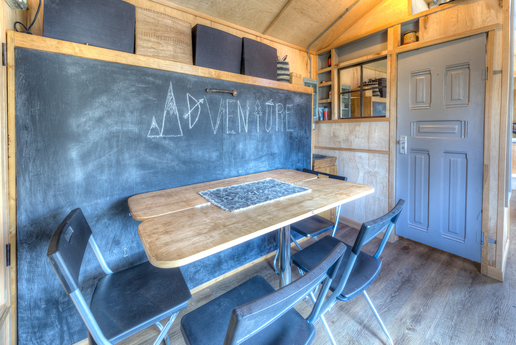 Lewis and Clarks Tiny House in Montana - Bed behind Table 2