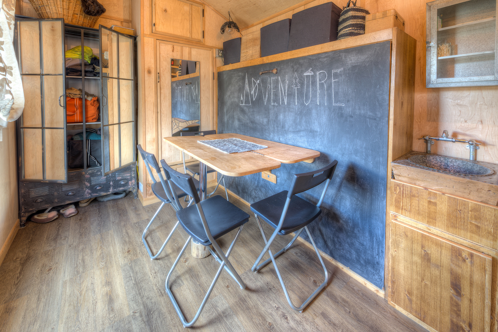 Lewis and Clarks Tiny House in Montana - Bed behind Table
